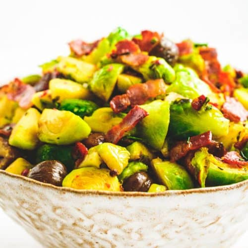 Bowl of Brussels sprouts with bacon and pink peppercorns