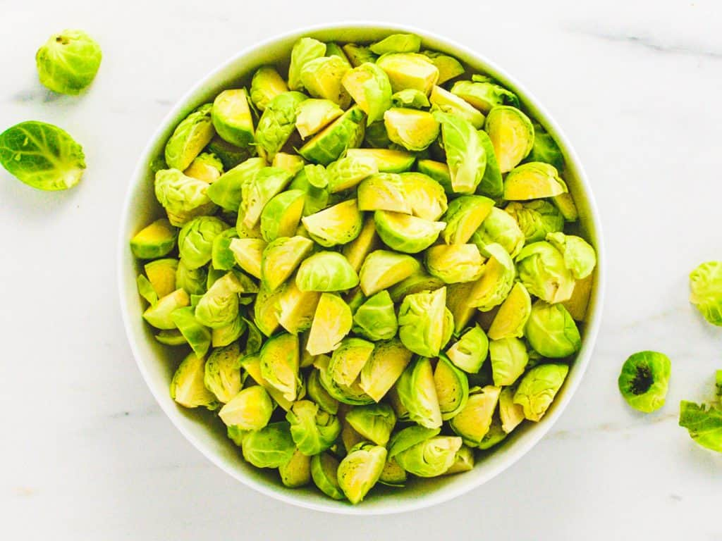 Raw Brussels sprouts chopped into quarters