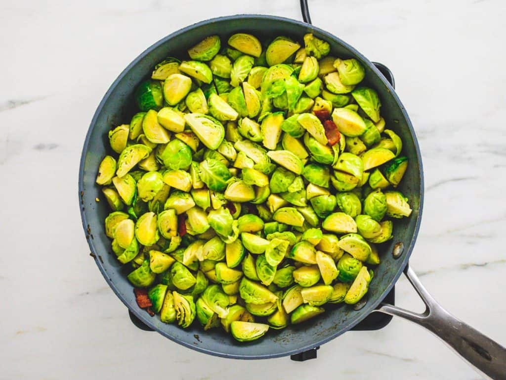 Bacon and Brussels sprouts in frying pan