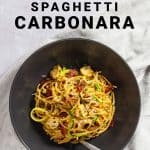 Bowl of healthy spaghetti carbonara in black pasta bowl