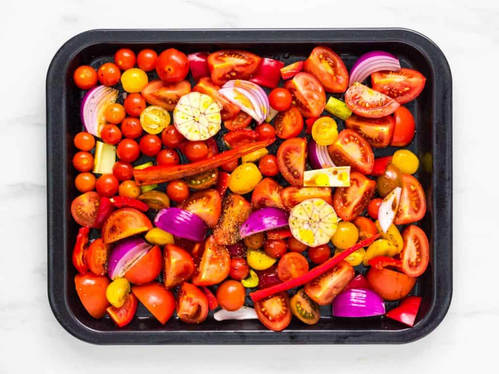 Raw vegetables on baking tray