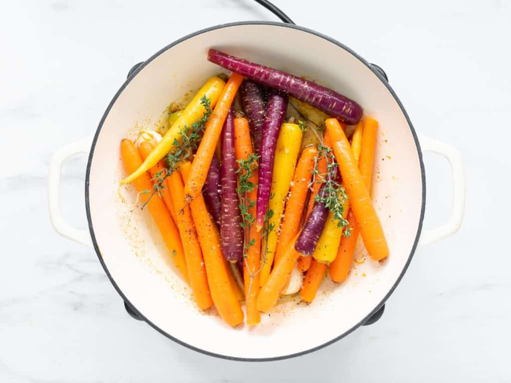 casserole pan with honey glazed carrots and thyme