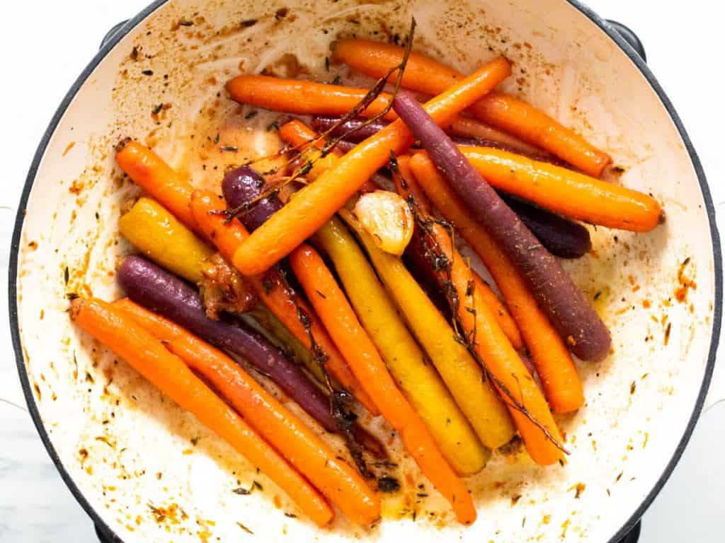cooked honey glazed carrots in casserole pan