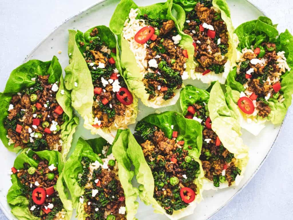 spiced lamb lettuce wraps on an oval platter