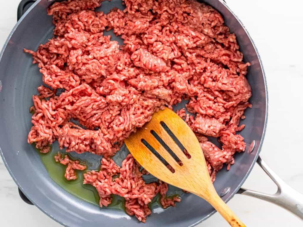raw lamb mince in frying pan