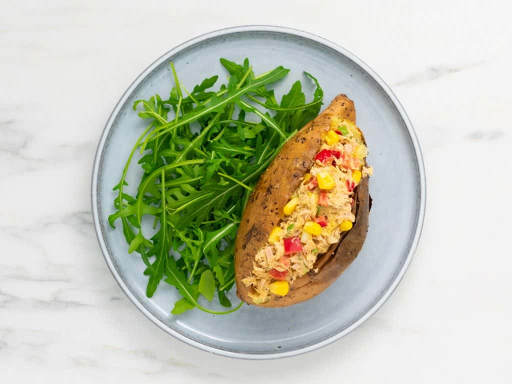 Sweet potato jackets with Tuna on a plate with rocket on the side