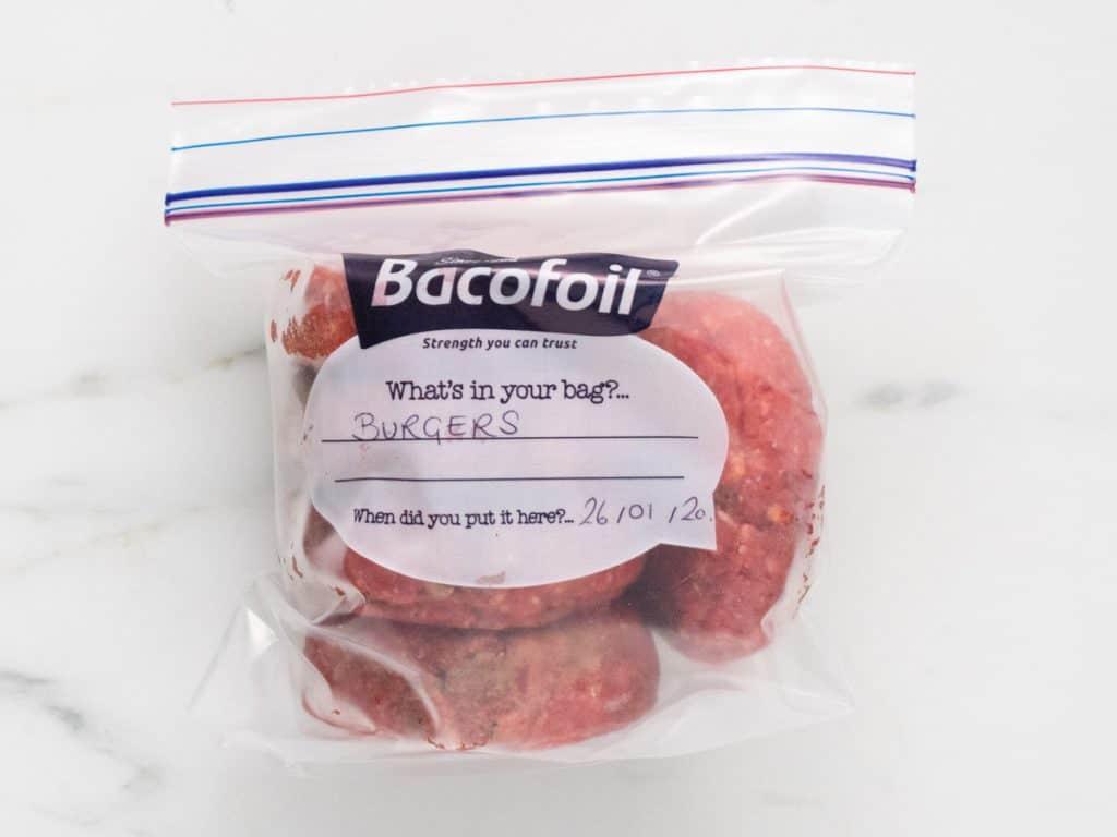 Freezer bag with four burger patties