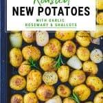 Roasted new potatoes with garlic, rosemary and shallots on a baking tray