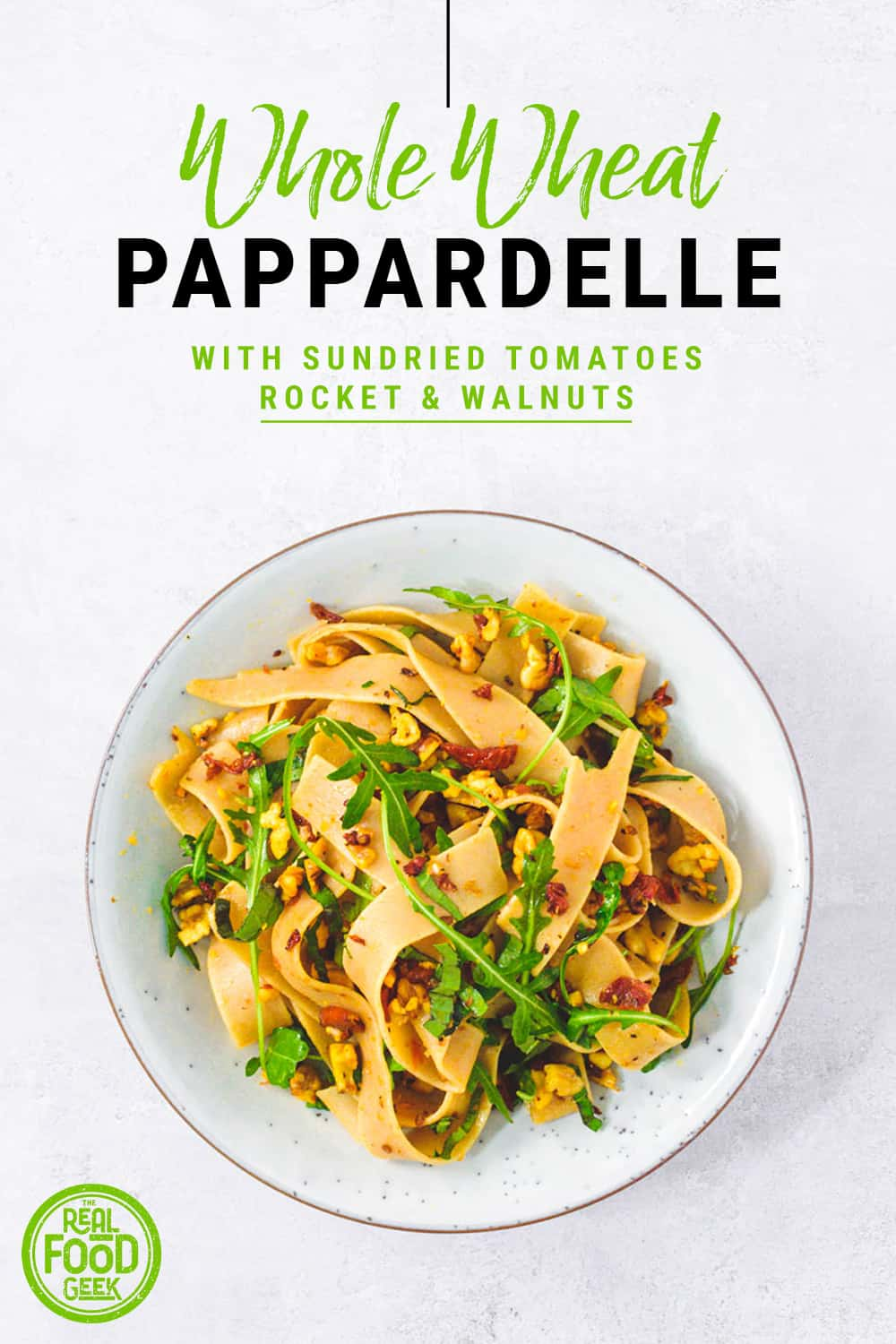 Birdseye view of whole wheat pappardelle with sundried tomatoes, rocket and walnuts