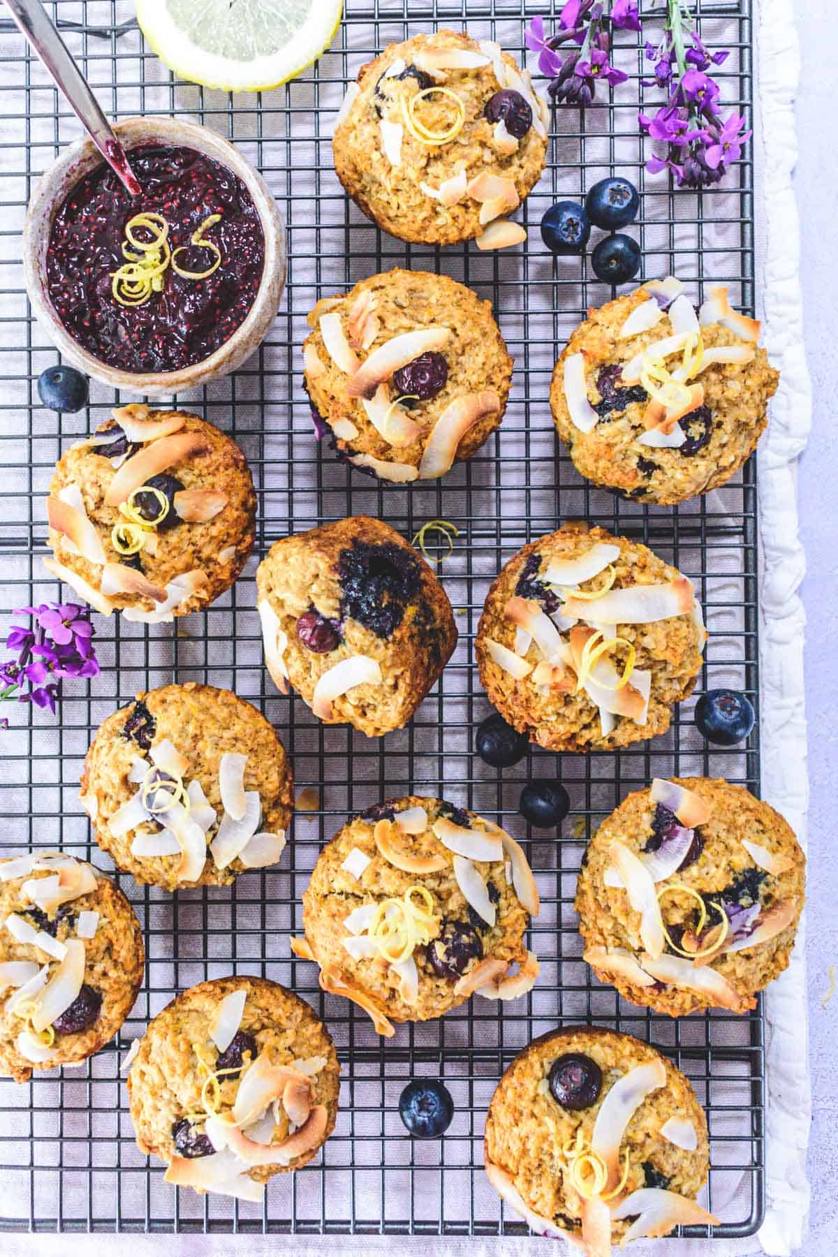 Coconut Blueberry Wholemeal Muffins arranged on a cooling rack
