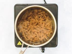 Pasta boiling in saucepan