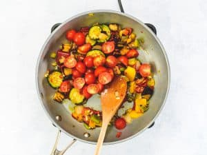 Mediterranean vegetables in a frying pan with chilli, garlic and cherry tomatoes