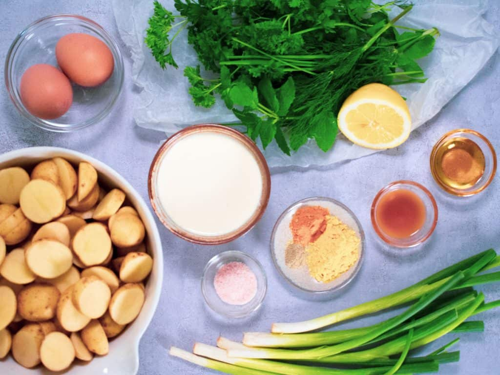 Ingredients for herby potato salad with homemade salad cream