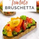 Tomato bruschetta randomly placed on a grey surface