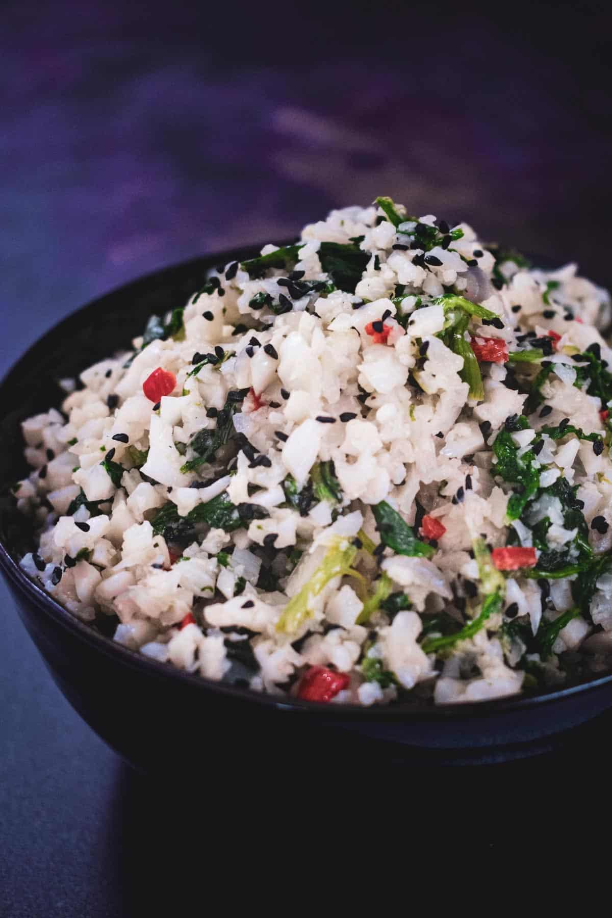Cauliflower rice in black bowl