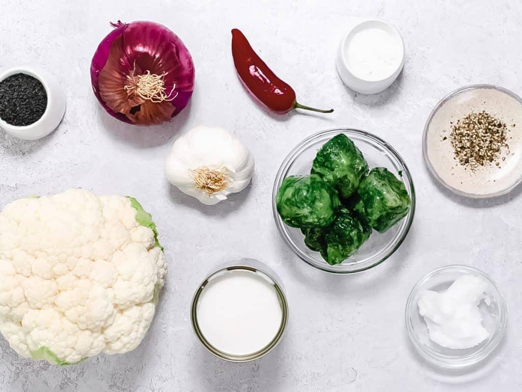 Cauliflower rice ingredients on grey background