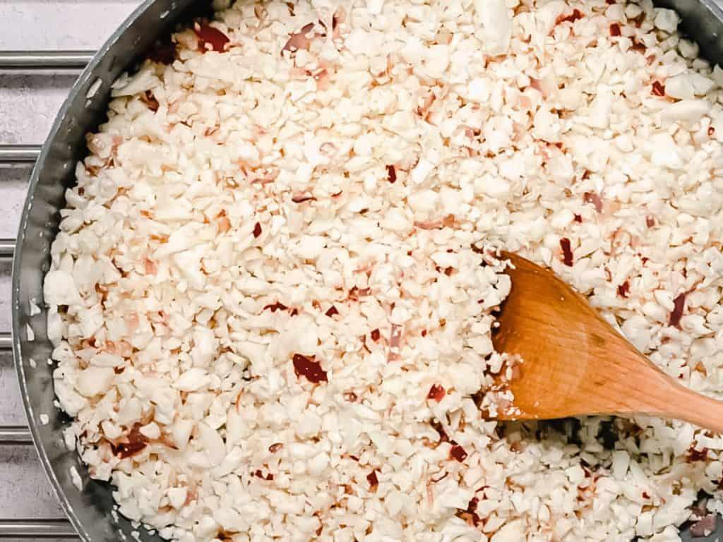 Cauliflower rice in a frying pan
