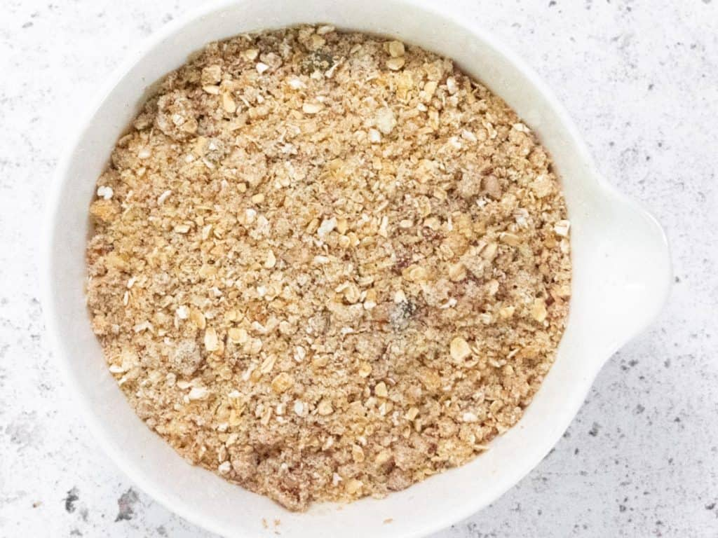 Bowl of oats, nuts and coconut oil