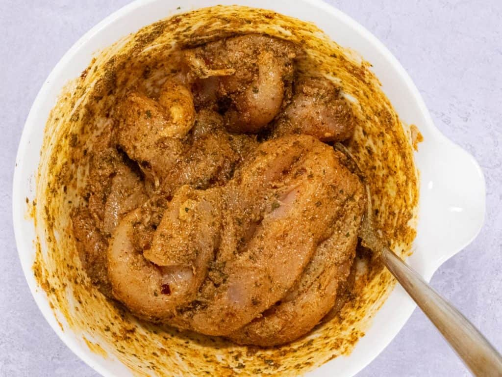 Chicken pieces marinating in tikka spices and yoghurt