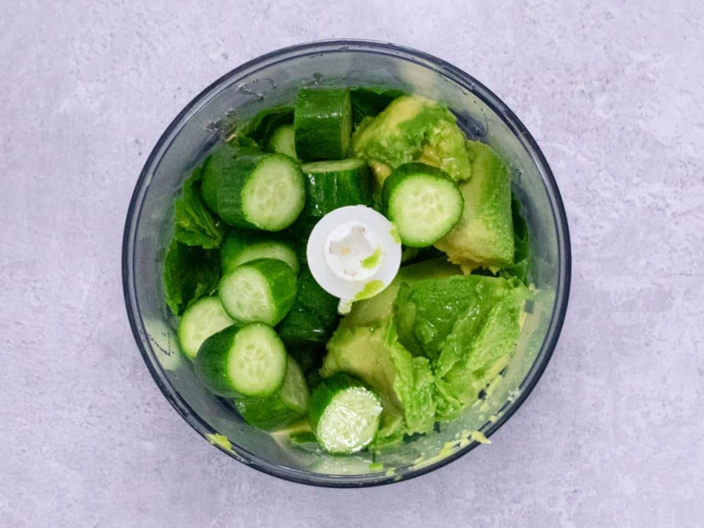 Avocado, mint and cucumbers in a food processor before blending