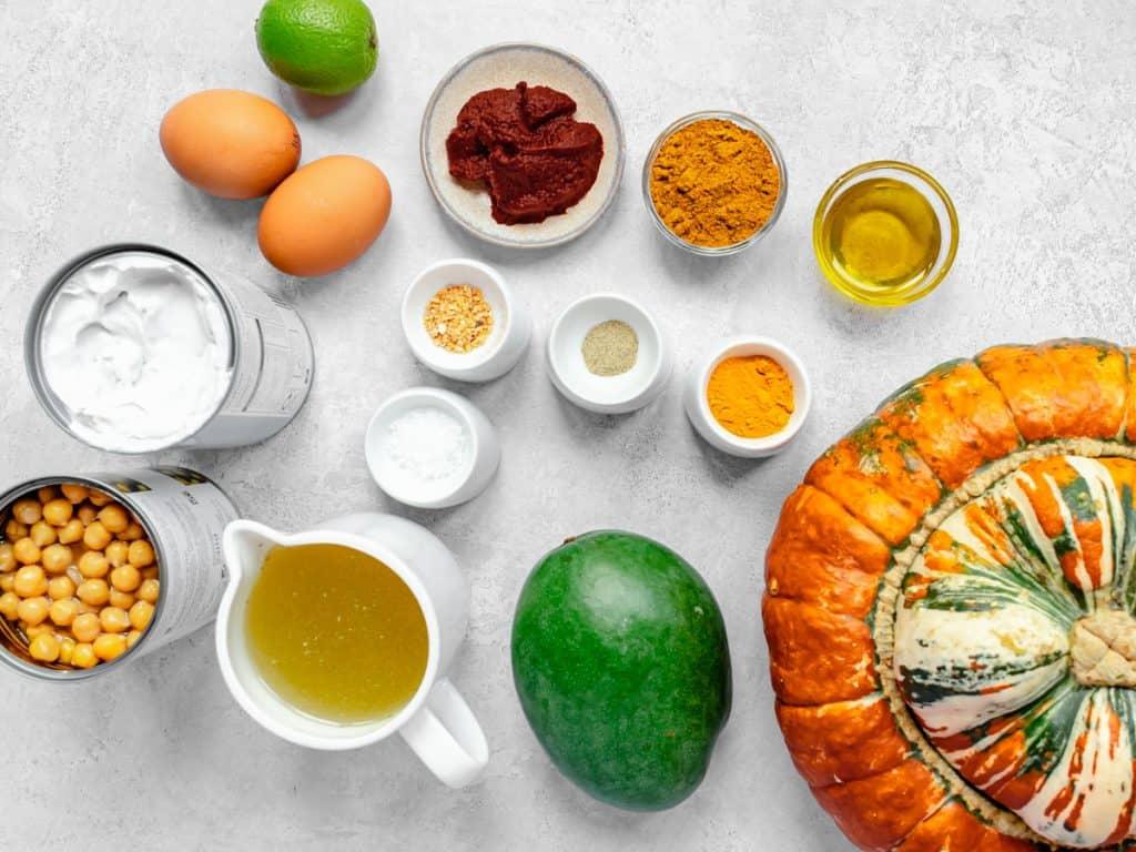 Roasted pumpkin soup ingredients on a grey tabletop