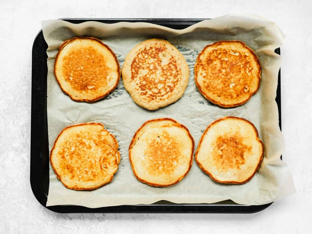 Keeping American style pancakes warm on a baking tray