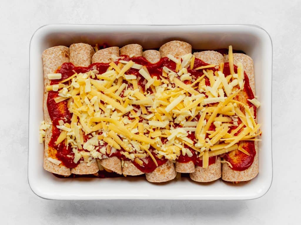 BBQ Chicken Enchiladas in baking dish topped with cheese